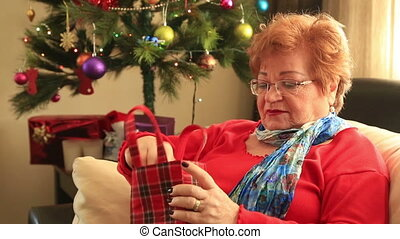 woman opening gift disappointed