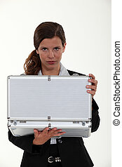 Woman opening metal briefcase