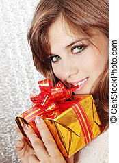 woman opens a gift