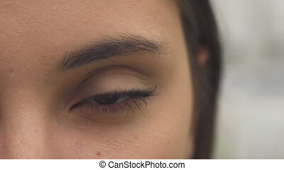 Woman opens her eye