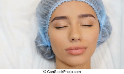 Woman opens her eyes after operation - Woman waking up on...