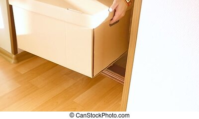 Woman opens the front door and takes a large cardboard box