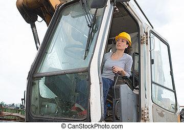 Woman operating grab machine