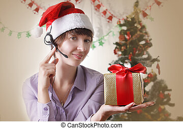 Woman operator on Christmas back with present