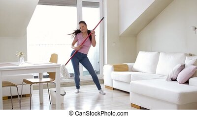 woman or housewife with mop cleaning floor at home - people,...