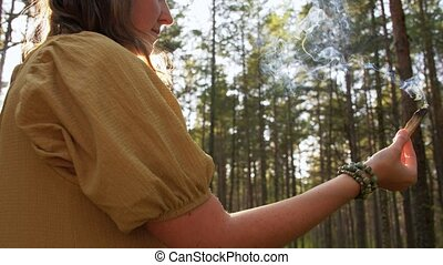 woman or witch performing magic ritual in forest - occult ...