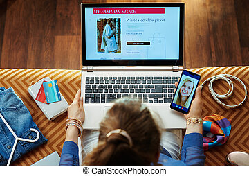 woman ordering clothes while shop online and having chat