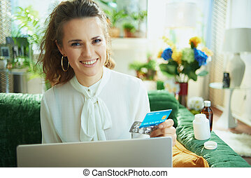 woman ordering medicine online in modern house in sunny day