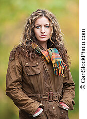 Woman out walking looking pensive
