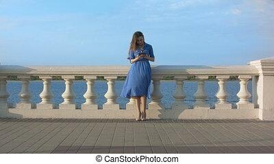 Woman outdoor using digital tablet.
