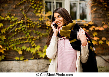 Woman outdoor with mobile phone