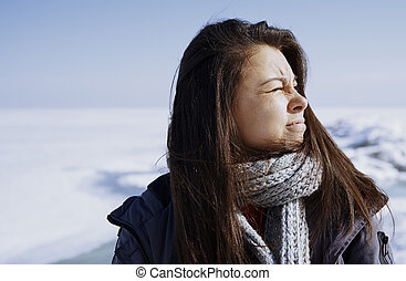 Woman outdoors traveling in winter icy landscape