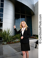Woman outside office building
