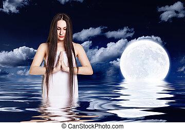 Woman over full moon
