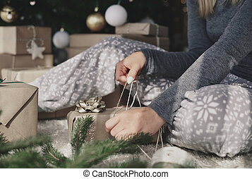 Woman packaging a christmas present