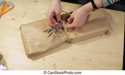 Woman packaging package in craft paper - Woman...