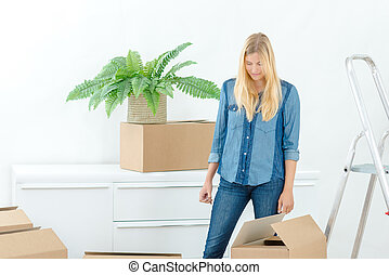 Woman packing a cardboard box