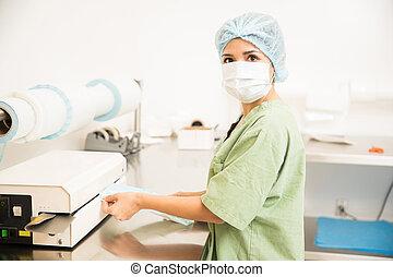 Woman packing and sealing medical tools
