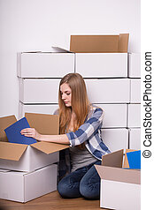Woman packing books