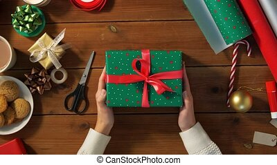 woman packing christmas gift at home - holidays, new year ...