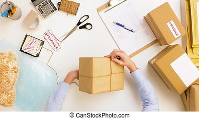 woman packing parcel box at post office - delivery, mail...
