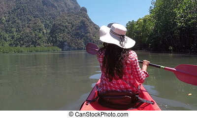 Woman Paddling Kayaking In Beautiful Lagoon Action Camera POV Of Girl Sitting On Kayak Boat