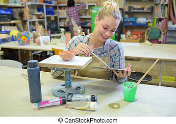 woman painting a finish model