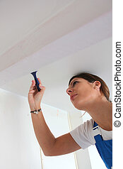 Woman painting a room white