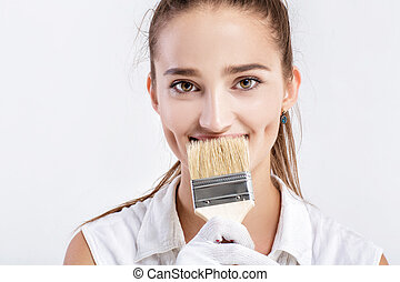 woman painting a wall in house