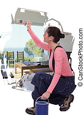 Woman painting on white wall