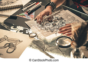 Woman painting picture at table