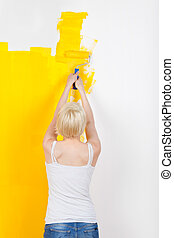 Woman Painting The Wall Yellow
