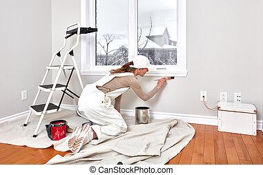 Woman painting trim