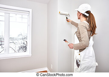 Woman painting wall - Painter woman painting room. House...