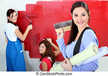 Woman painting wall red