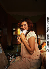 woman painting with airbrush gun