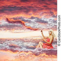 woman paints a sunset