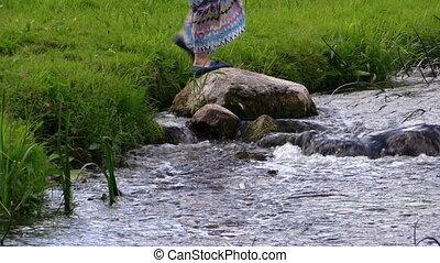 woman paper ship river