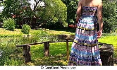 woman park bench sun - nice pregnant woman sit in the garden...