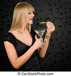 Woman party dress hold cocktail eat olives