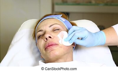 mask facial - woman passes treatment mask facial at the...