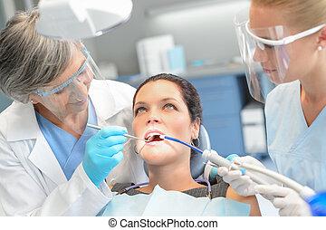 Woman patient dental check dentist team