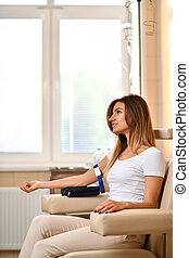 Woman patient waiting in doctor cabinet for the blood collection. Medical concept