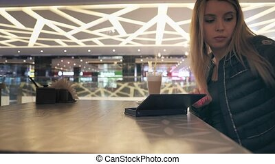 woman pay bill cafe - Young attractive woman pays the bill...