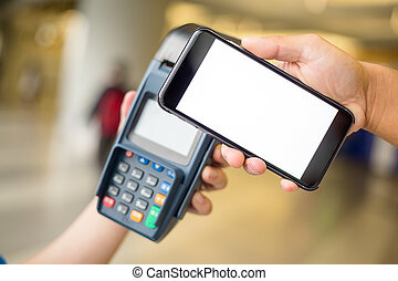 Woman pay by smartphone with NFC