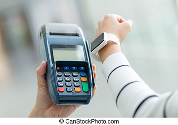 Woman pay by smartwatch with NFC