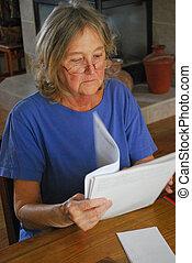 Woman paying bills.