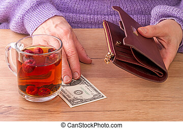 Woman paying for tea