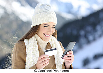 Woman paying on line in winter holidays