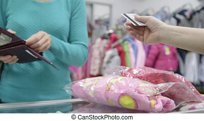 Woman paying with credit card at clothes shop